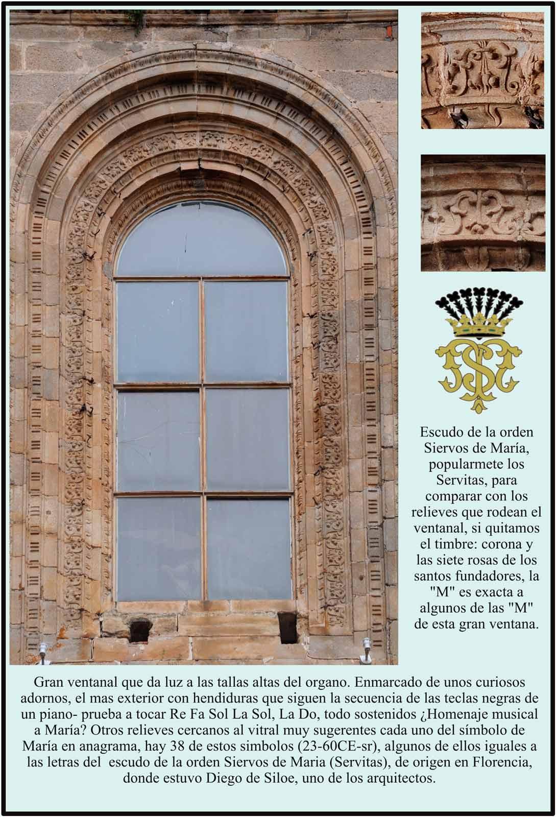 Gran ventanal y simbolos en anagrama de Maria en la fachada del Enlosado
